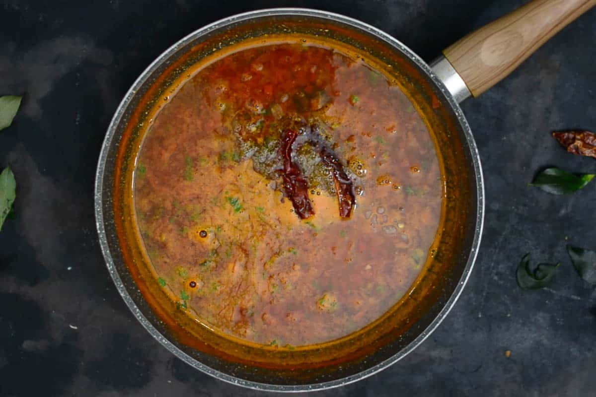 Tempering poured over ready rasam.
