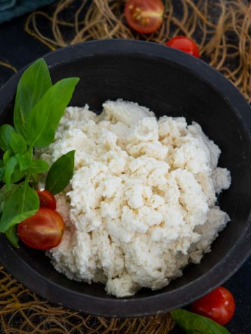 Made using just 4 ingredients, homemade ricotta cheese is a breeze to make. Once you make it at home, you will never buy a tub again. It is rich, creamy, made using real ingredients, and super economical than the store-bought one.