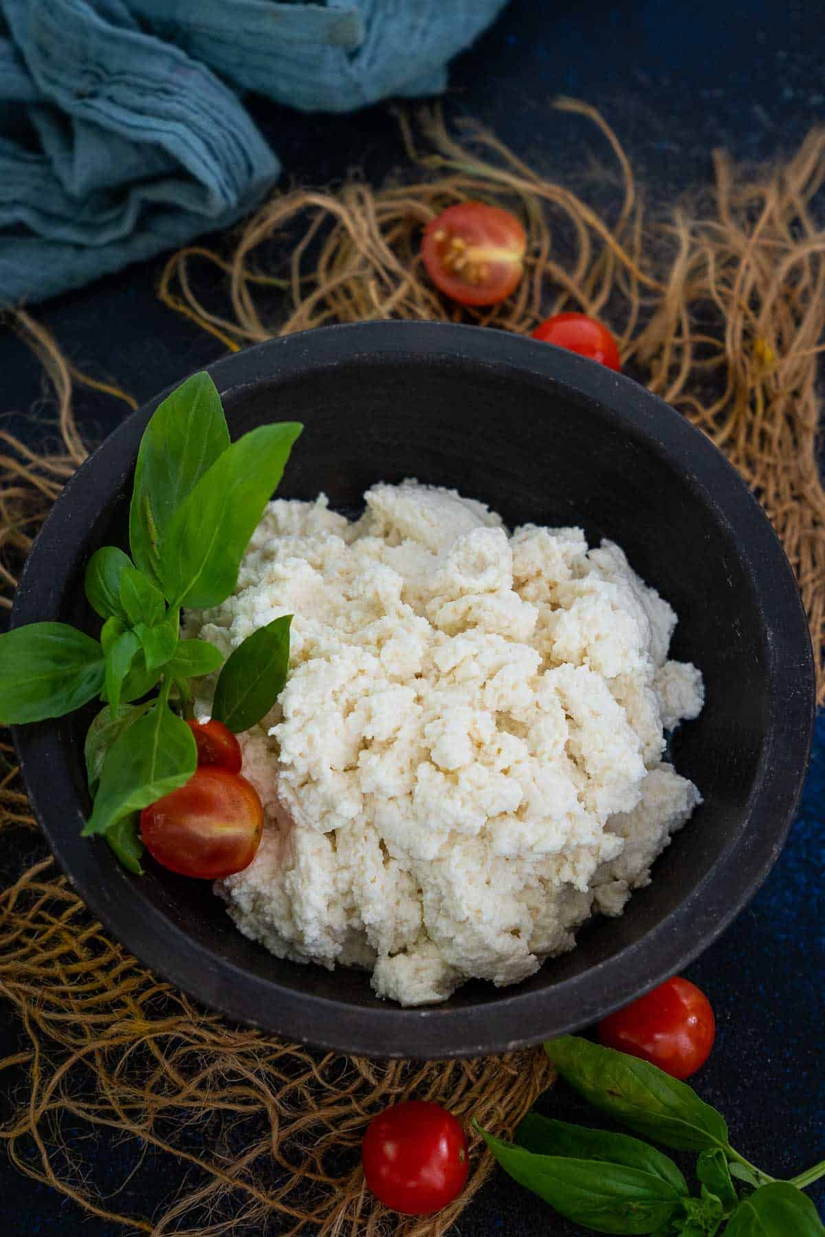 Homemade ricotta cheese served in a bowl.