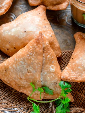 Make crispy and flaky Punjabi samosa at home using my simple recipe. Lots of tips and tricks to make the perfect samosa are included in the post.