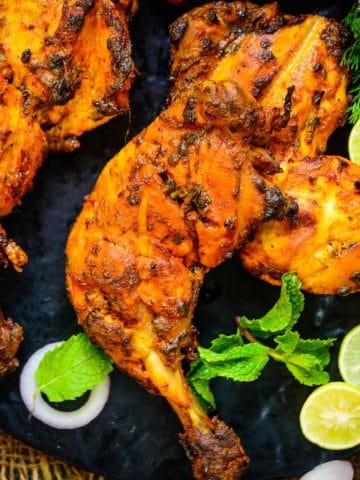 Make restaurant-style tandoori chicken at home in an oven, air fryer, or grill. It takes just 15 minutes of actual working time and is super healthy, gluten-free, and keto-friendly too.