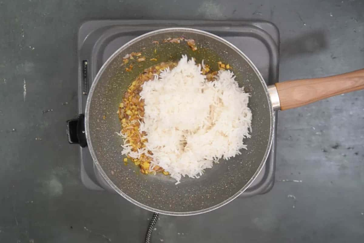 Cooked rice added to the pan.