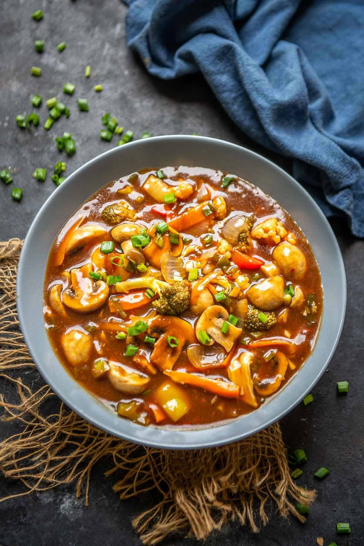 Vegetables in hot garlic sauce served in a bowl.
