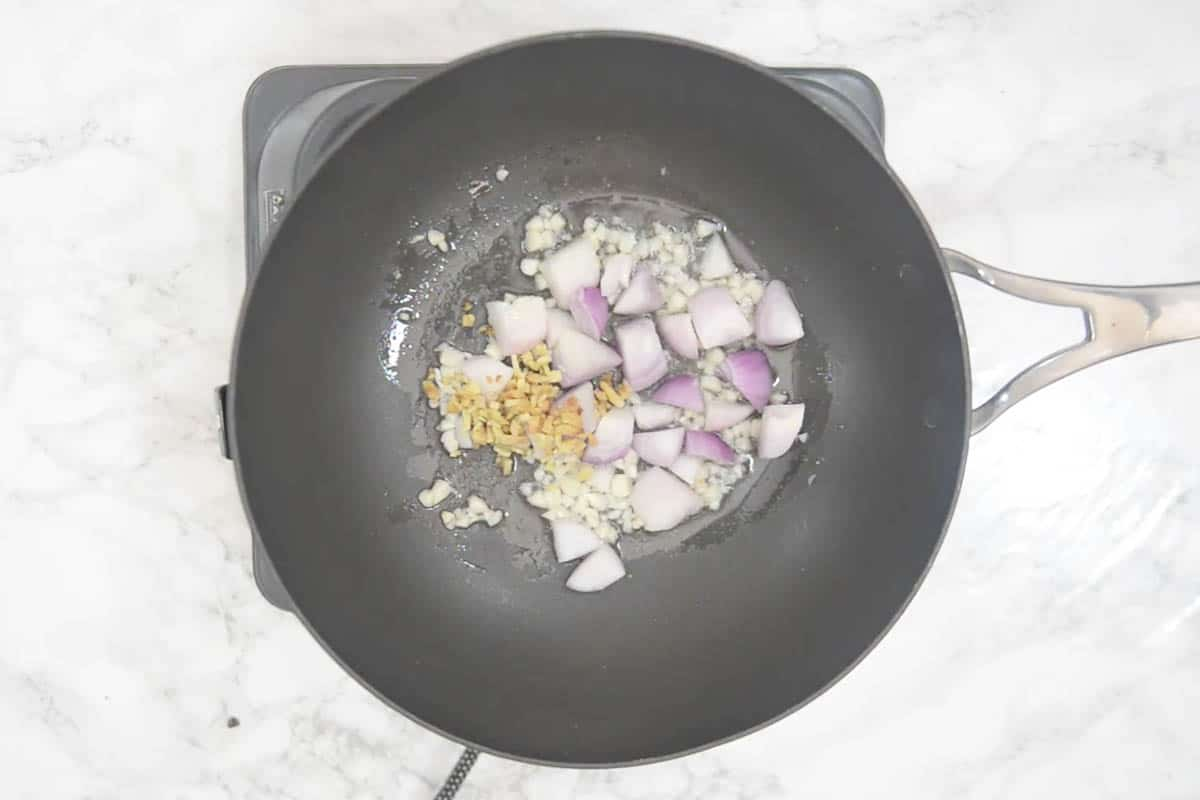 Onion and ginger added to the wok.