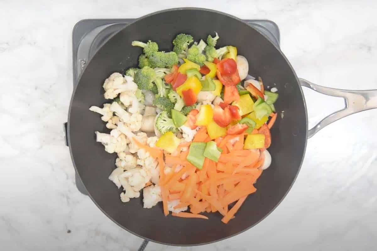 Veggies added to the wok.