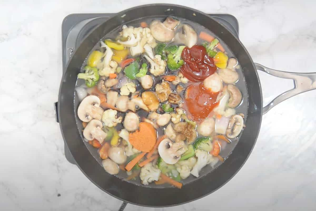 Sauces added to the wok.