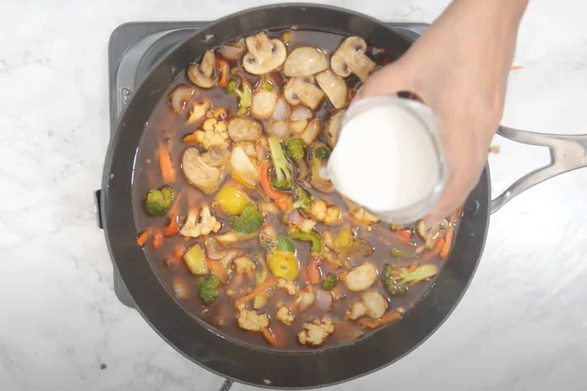 Cornstarch slurry added to the wok.
