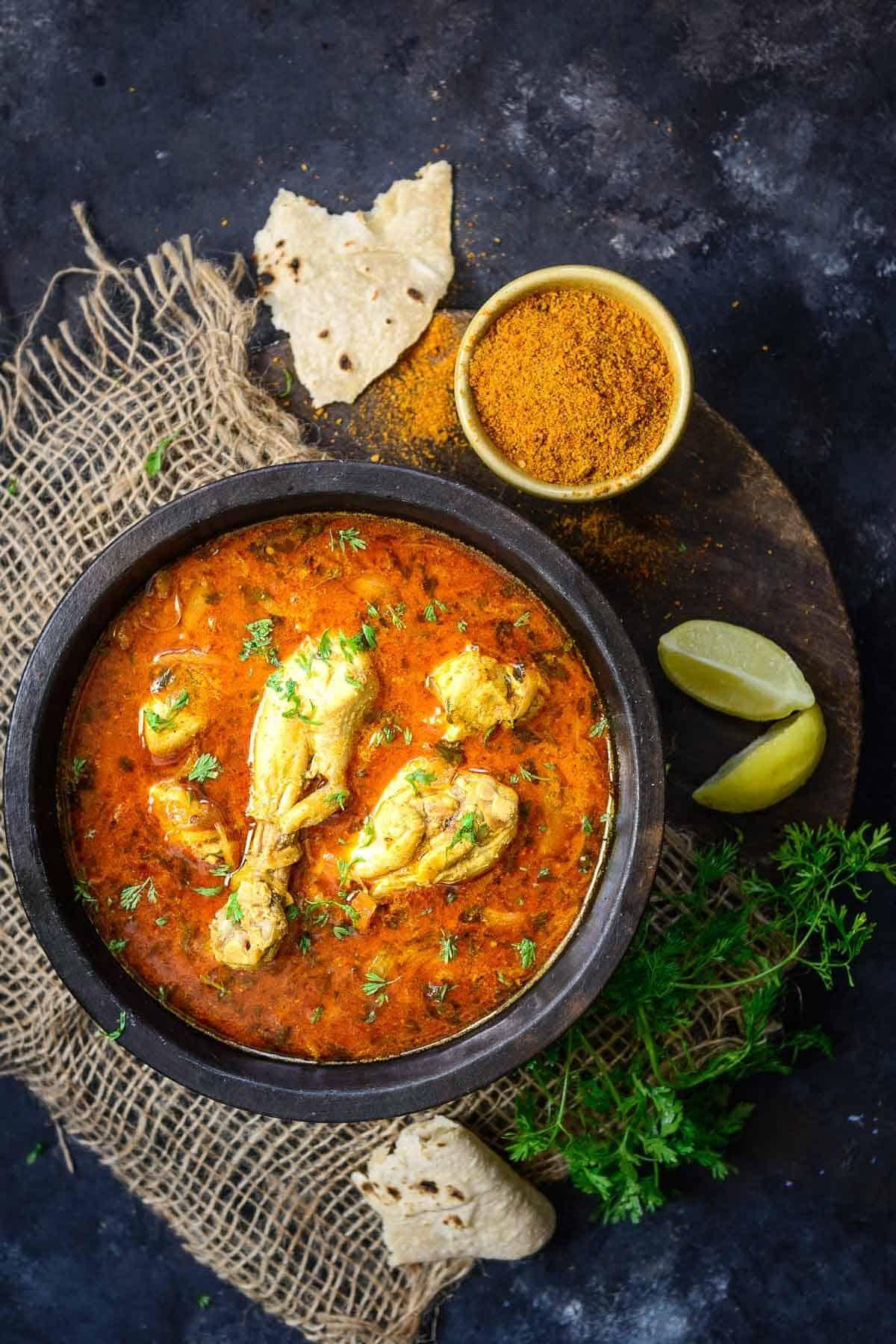 Achari chicken served in a bowl.