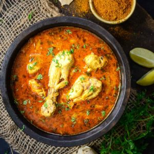 Achari Chicken is an Indian chicken curry flavored with pickle masala or achar masala. It goes great with Indian bread or rice dishes. Here is how to make it.