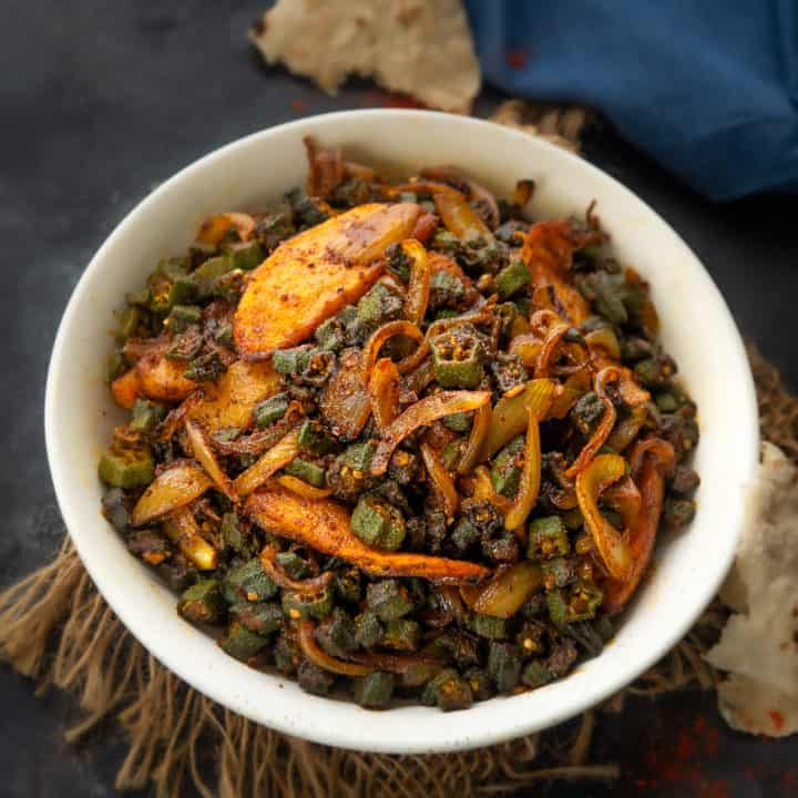 A simple everyday Indian stir fry, Aloo Bhindi is made with the combination of potatoes and Okra with some basic spice powders. Here is how to make it.