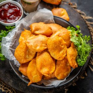 Aloo Pakora is a vegan Indian snack where thinly sliced potatoes are coated with a spiced batter and deep-fried until crispy. This 30 minutes snack is best enjoyed with green chutney and masala chai on the side. Try it!