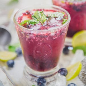 Mix up this white rum Blueberry Mojito Cocktail in under 5 minutes using fresh or frozen blueberries and sip it like a royal! You can also make a Non-Alcoholic or a Virgin version of this recipe.