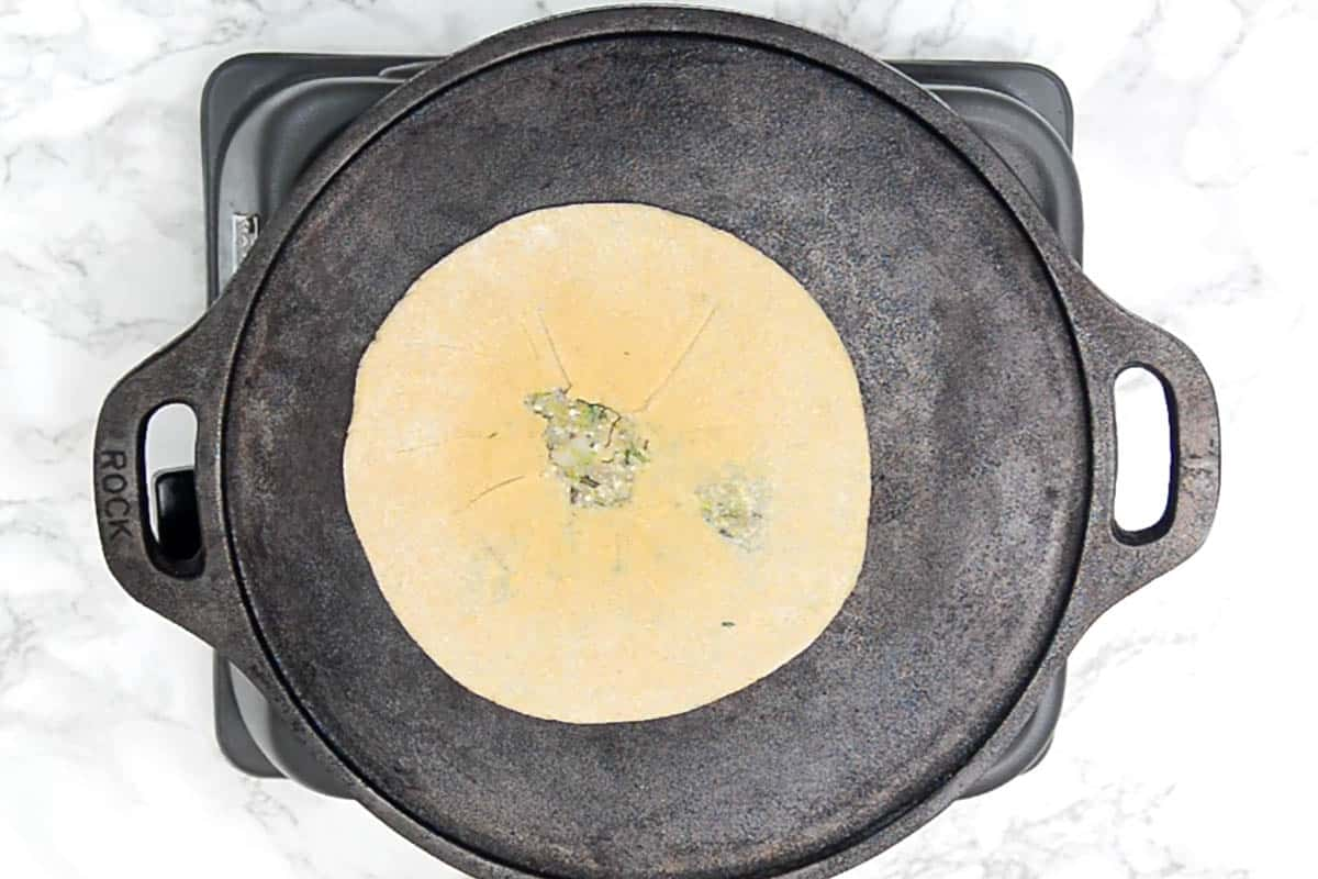 Paratha transferred on the hot griddle.