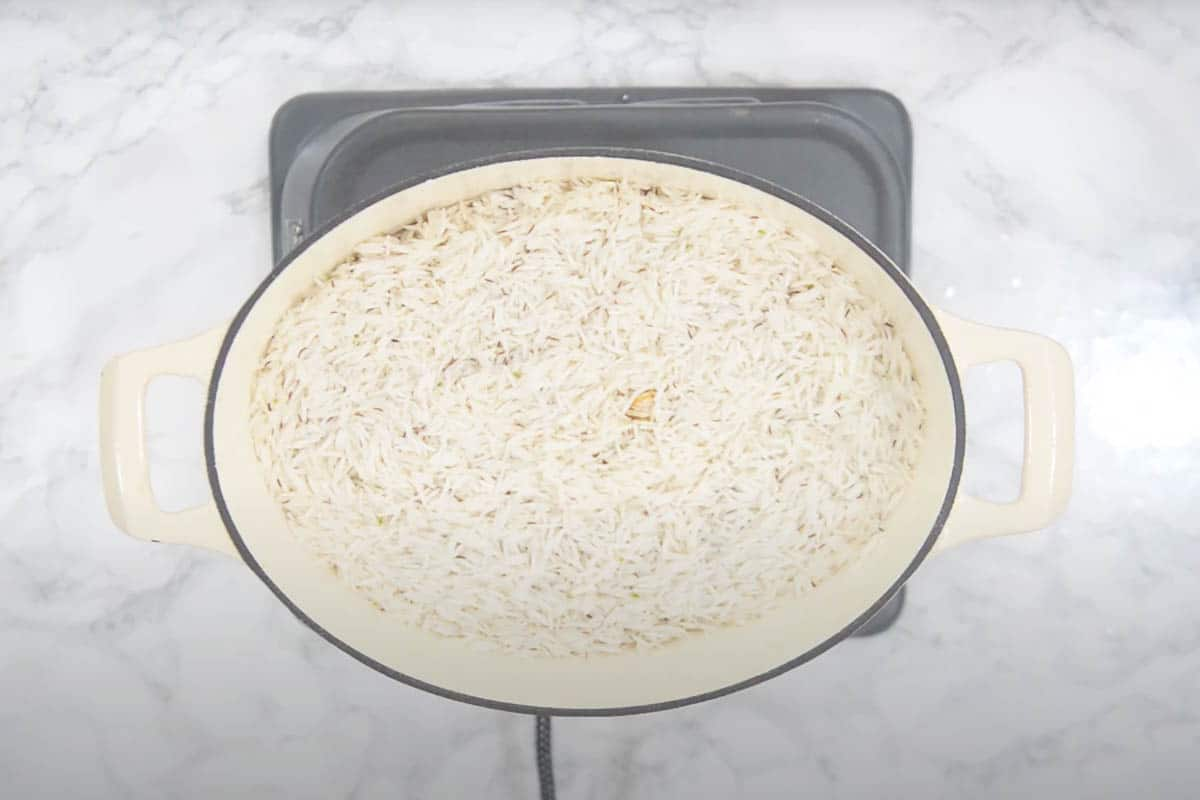 Rice layered over the chicken.