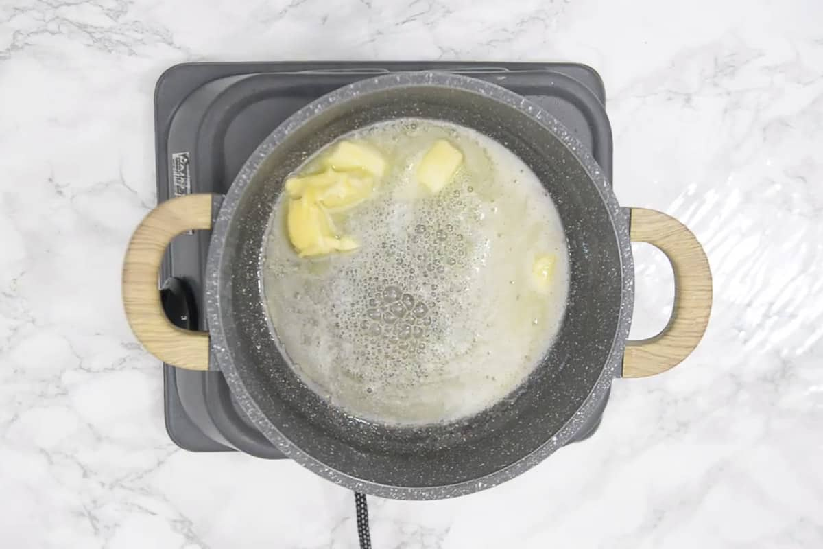 Butter heating in a wok.