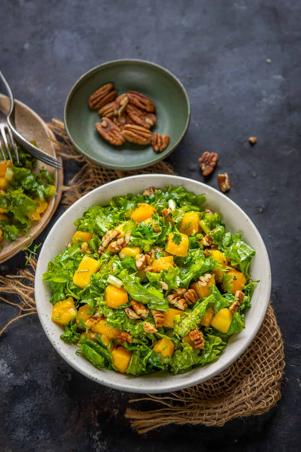 Kale Mango Salad served in a bowl.