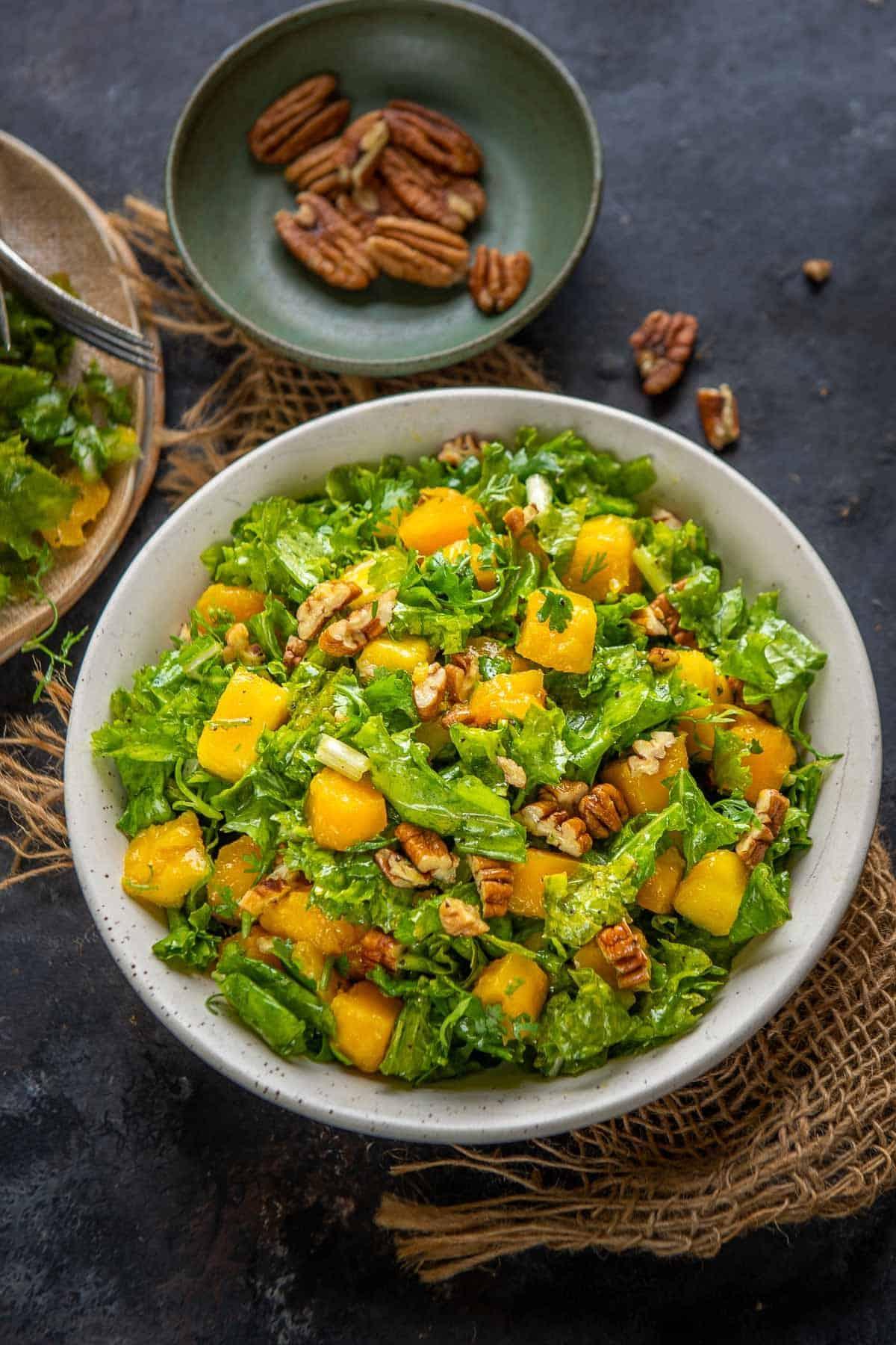 Kale mango salad served in a bowl.
