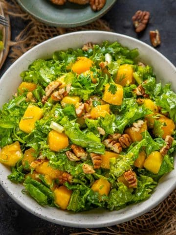 This healthy kale mango salad is a must-make recipe while mangoes are in season. It's easy to make, comes together in 5 minutes, can be made vegan, and makes for a great light side dish, lunch or dinner.