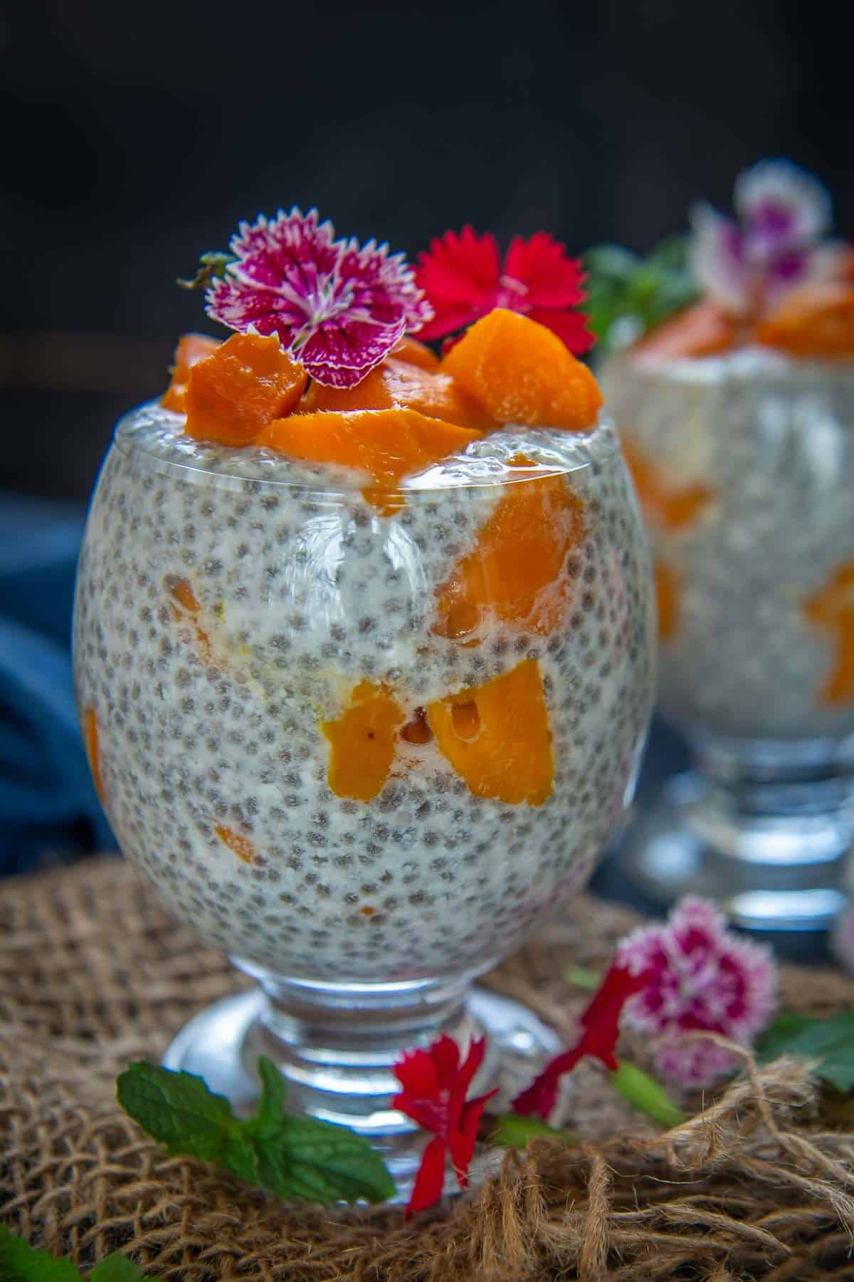 Mango chia pudding served in a glass.