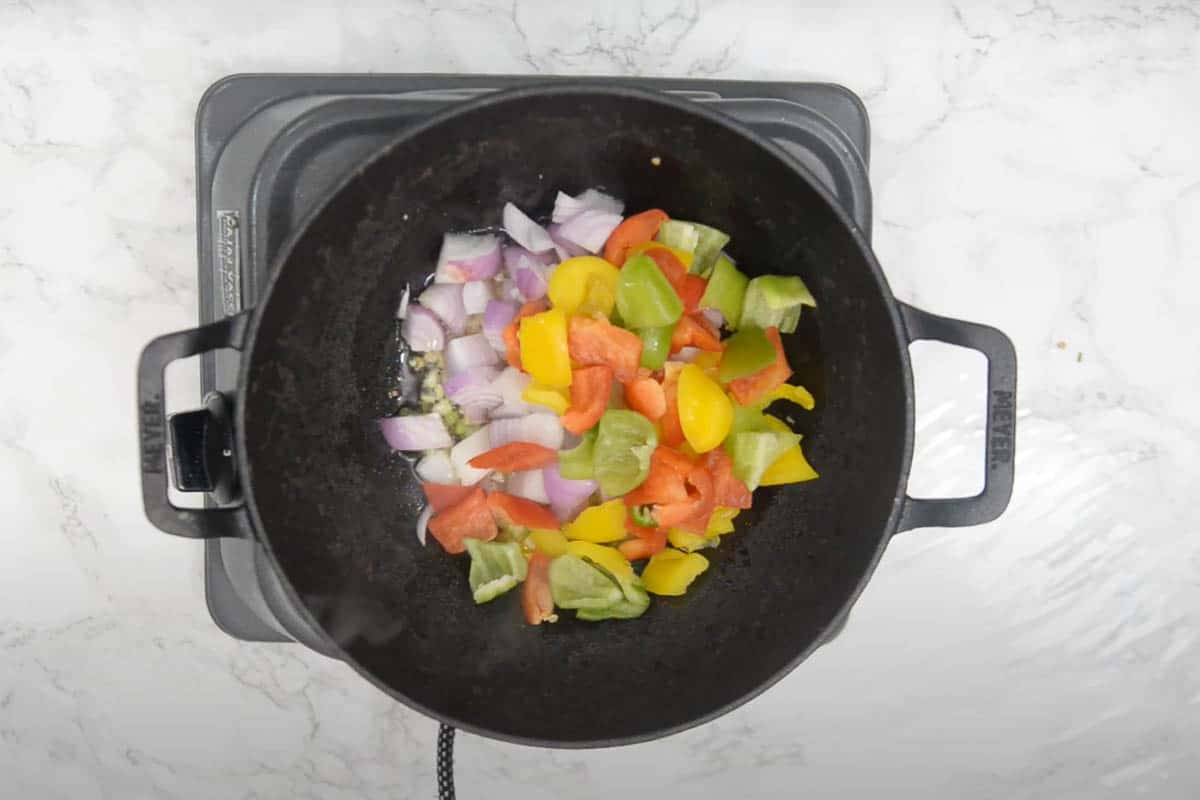 Onion and bell pepper added to the pan.