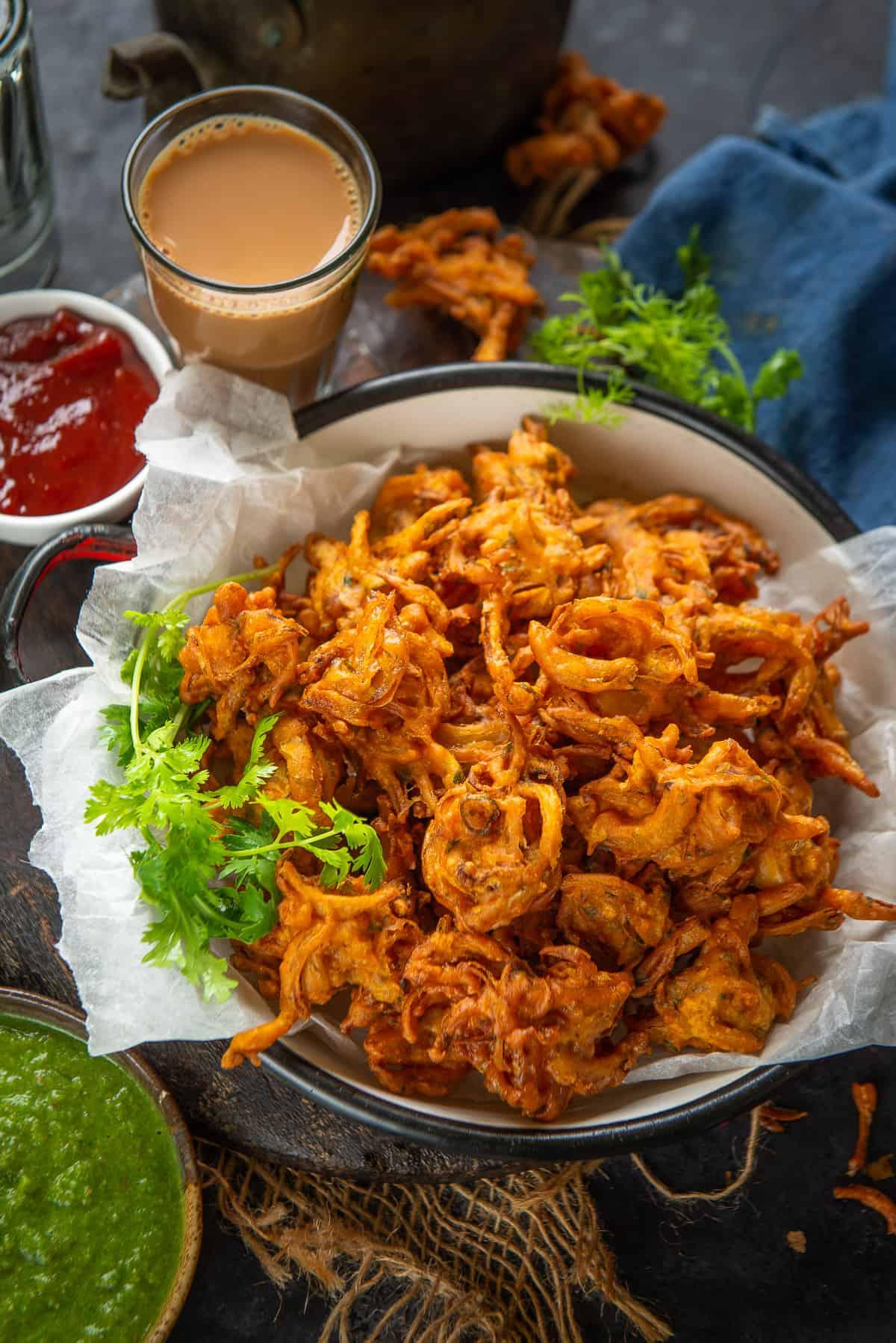 Onion Pakoda served on a plate.