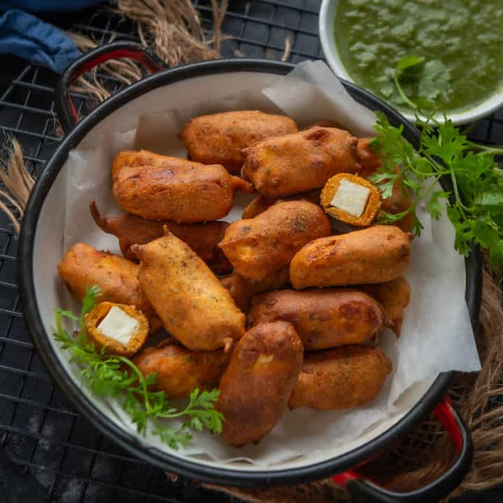 Crispy Paneer Pakora is a popular Indian fritter, where paneer pieces are dipped in spiced gram flour batter and deep fried, making it a perfect Monsoon snack. Here is how to make it.