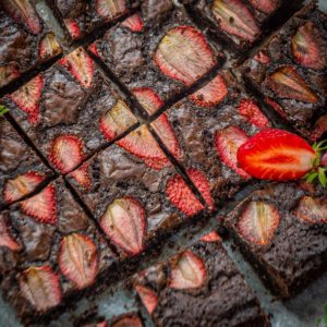 These fudgy Strawberry Brownies are chocolate brownies with the added flavor of fresh strawberries in each bite. These are easy to make and super delicious to eat. Here is how to make it from scratch.
