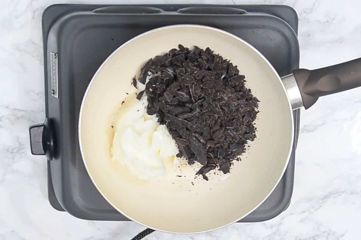 Chocolate and butter in a pan.