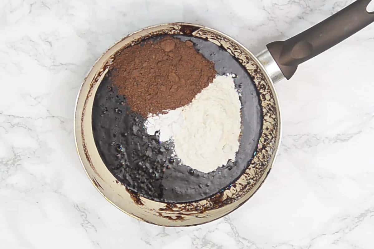 All purpose flour, cocoa powder and baking powder added to the pan.