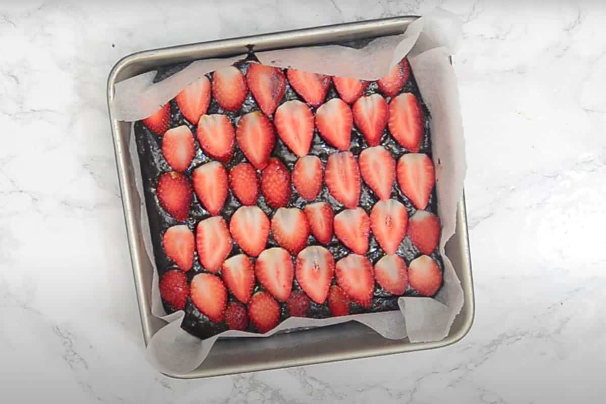 batter topped with strawberry slices.