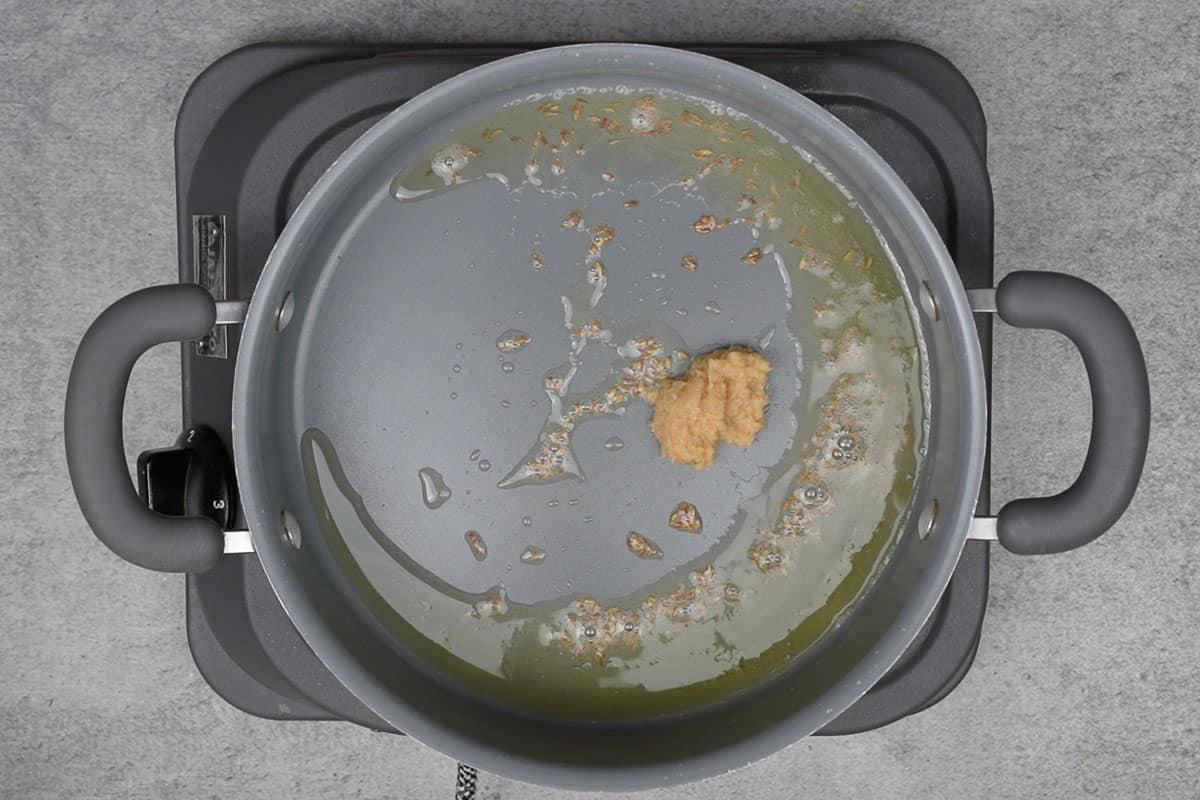 Ginger garlic paste added to the pan.
