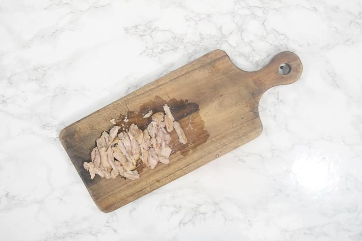 Chicken cut into thin slices.