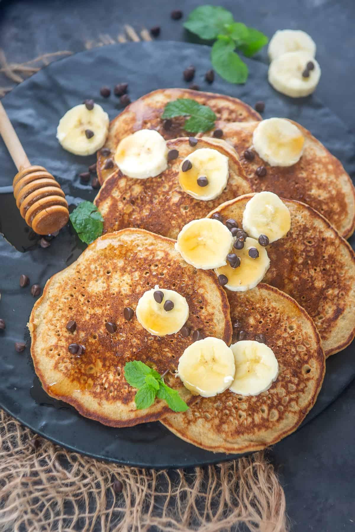 Banana Oatmeal Pancakes served on a plate.