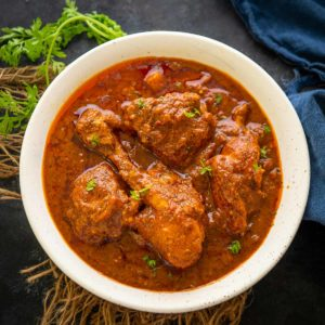 Vindaloo is a Portuguese-influenced dish made by cooking the meat with spices and vinegar. Learn to make chicken vindaloo in a traditional way using my easy recipe.