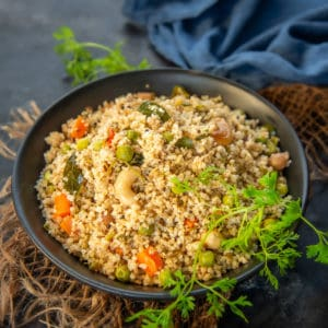 Quick and easy to make, Dalia Upma or Broken Wheat Upma is a healthy breakfast option that can be made in a jiffy. It's Diabetics friendly and great for weight loss.