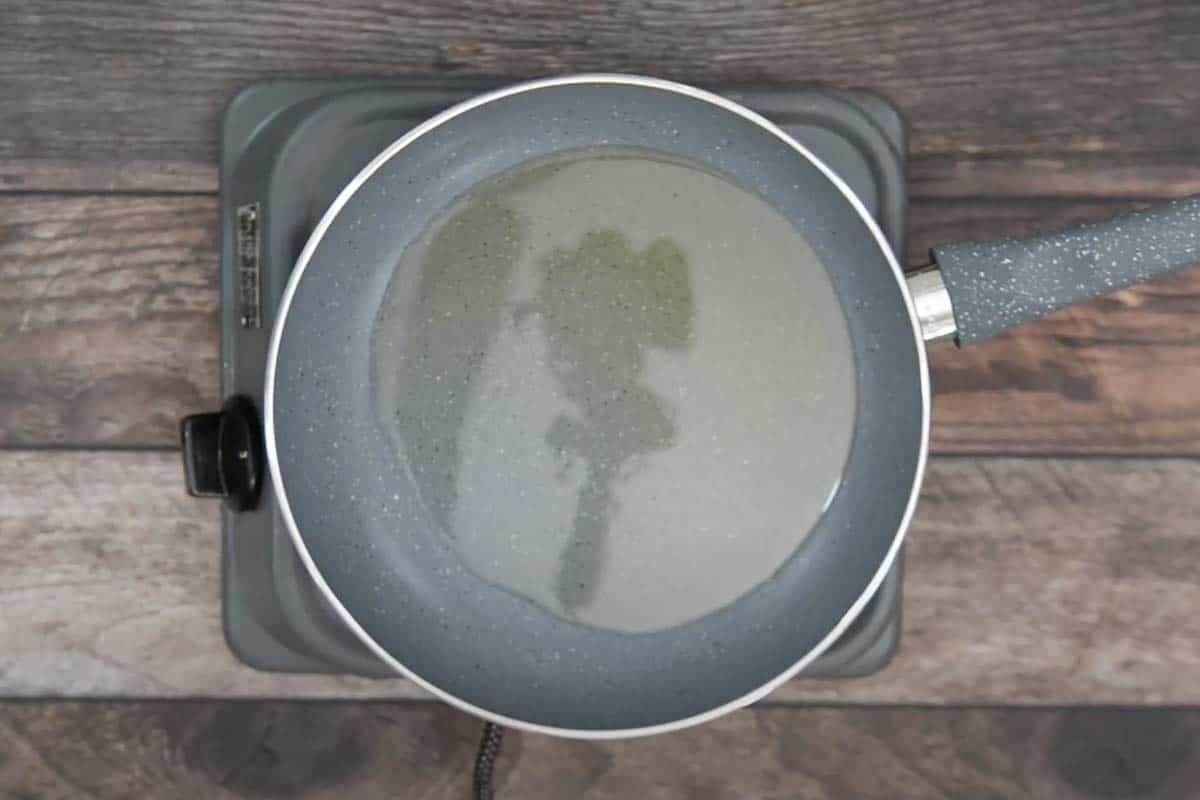 Oil for shallow frying heating in a pan.