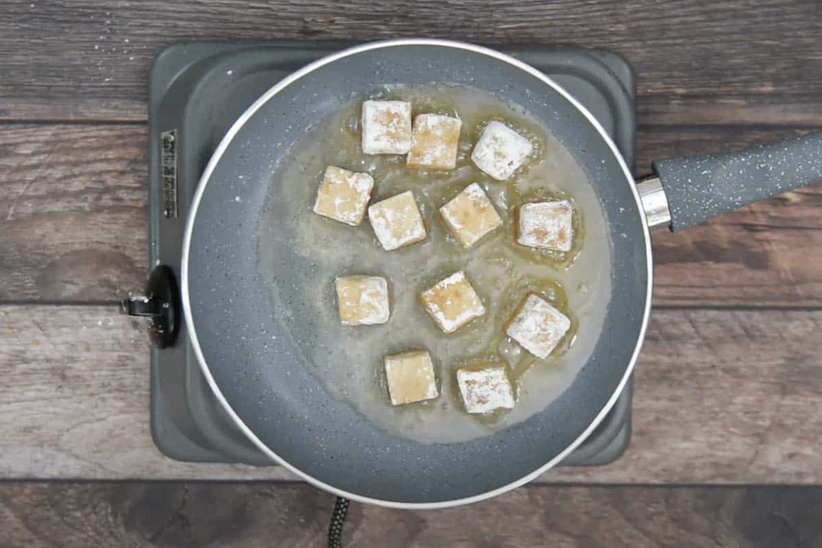 Tofu frying in the oil.