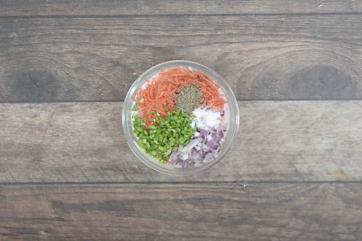 Dressing ingredients added to a bowl.