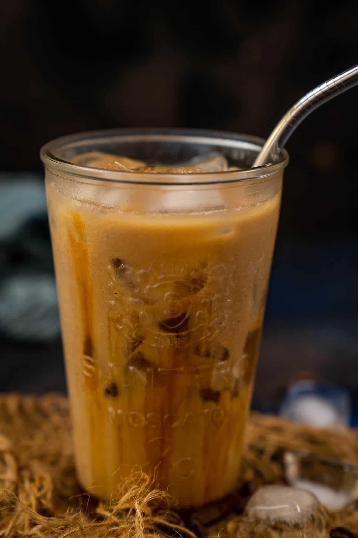 Iced Caramel Macchiato served in a glass.