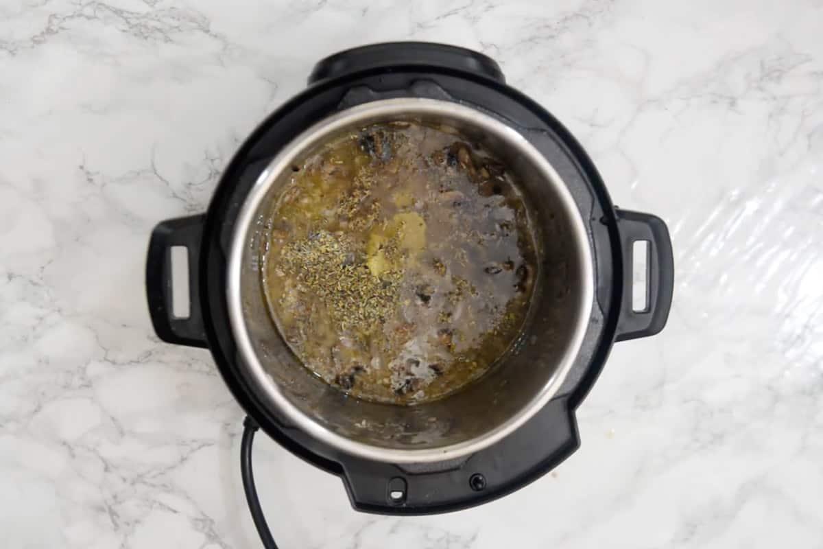 Chicken stock, Italian seasoning and marsala wine added in the pot.