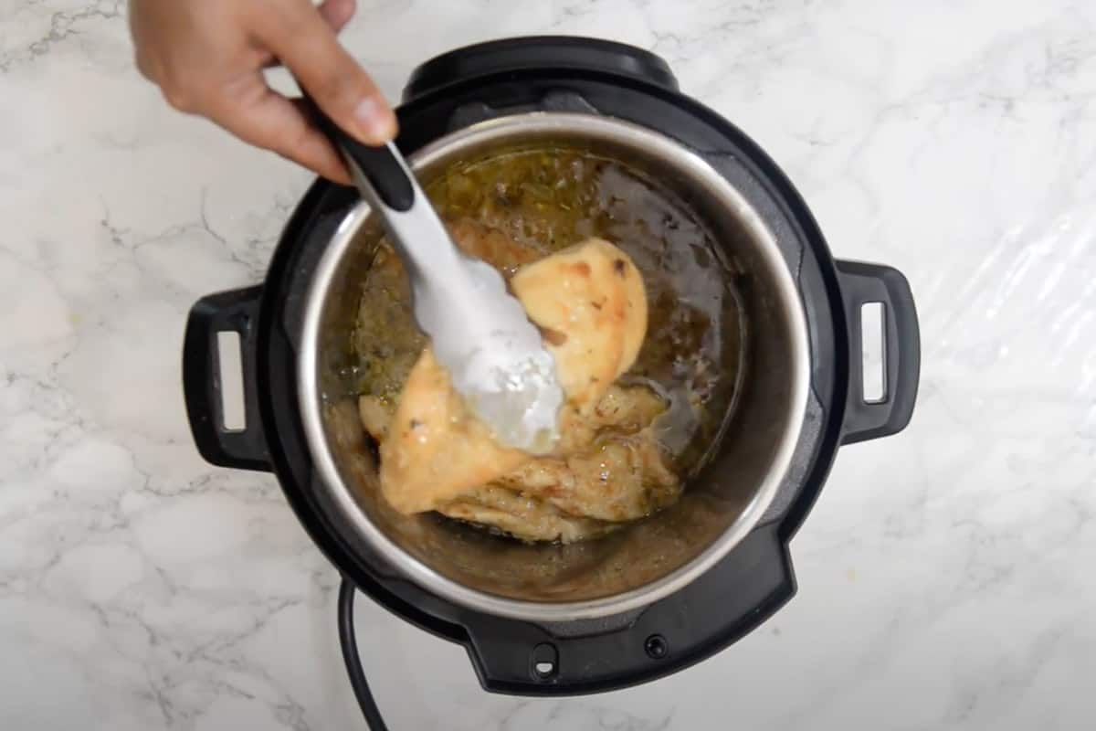 Chicken removed from the pot.