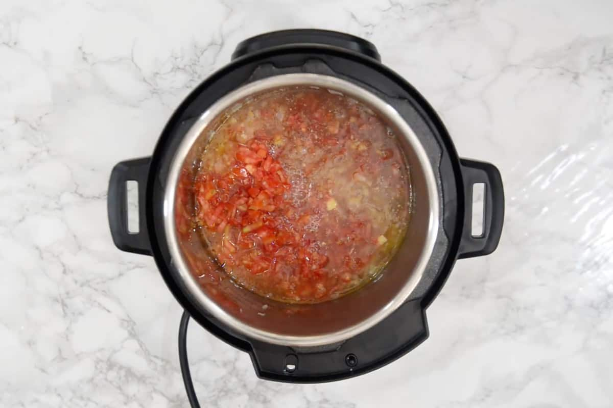 Tomato and vegetable stock added in the pan.