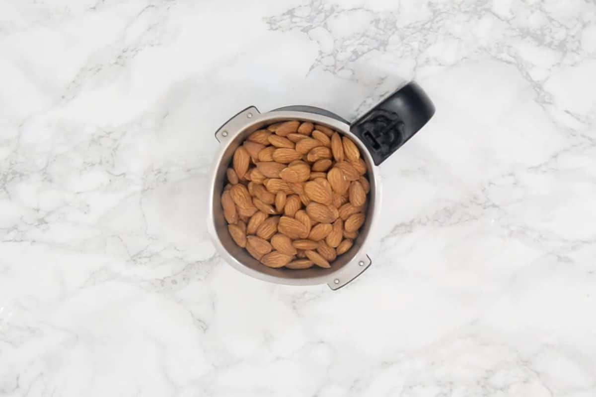 Almonds added in a grinder.