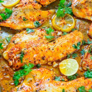 This oven-baked lemon garlic baked tilapia is super easy to make and comes together in under 20 minutes. It's low carb, gluten-free, keto-friendly, and very flavorful. Here is how to make it.