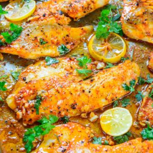 This easy spicy lemon garlic baked tilapia is one of the best tilapia recipes you can make at home. It takes all of 5 minutes of preparation time before you pop it in the oven. Pair it with sautéed vegetables and steamed rice for a hearty meal.
