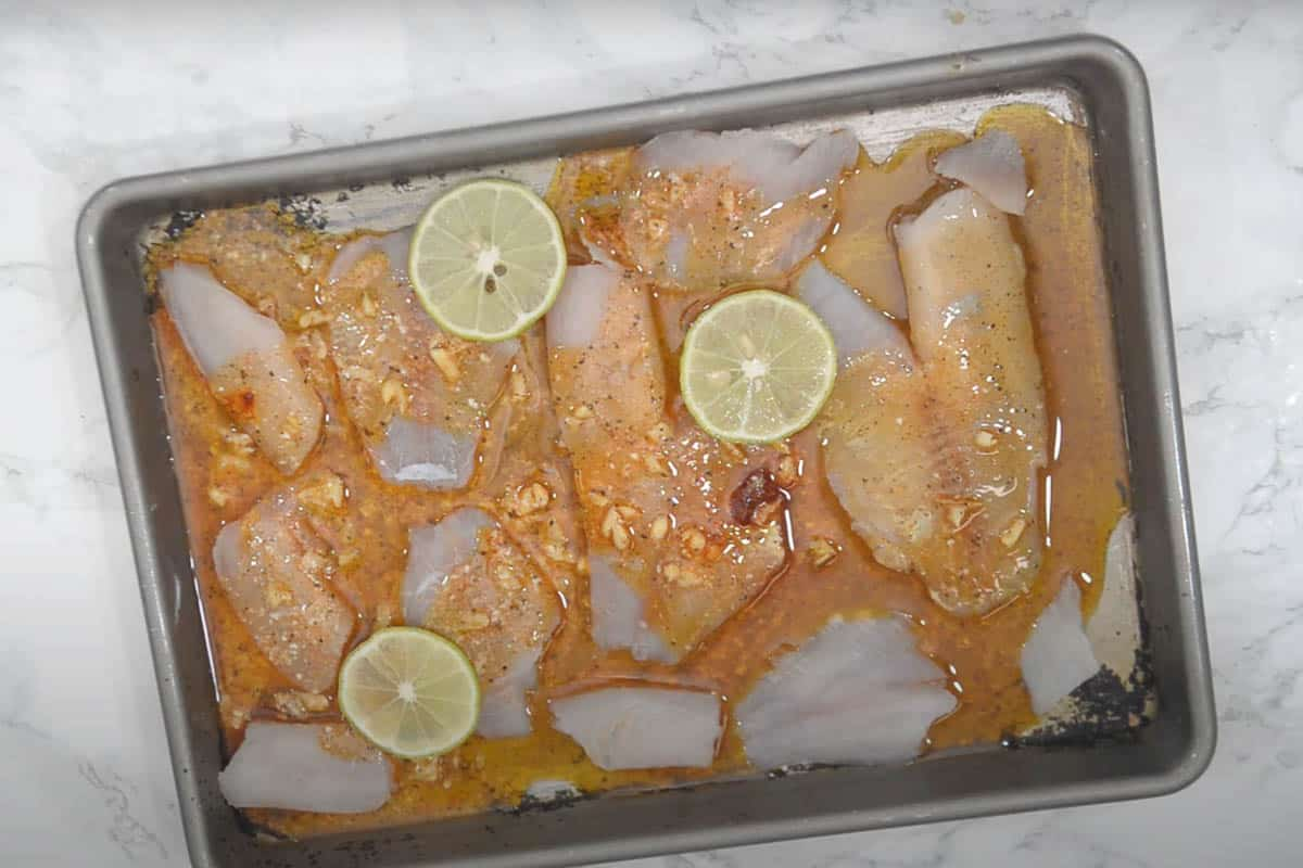 Marinade poured over the fillets.