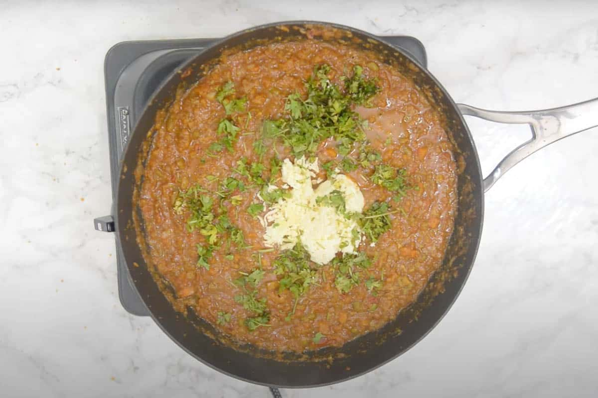 Paneer, lemon juice, salt, and coriander added to the pan
