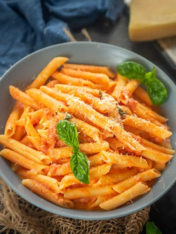 This Penne Alla Vodka is an easy to make creamy pasta in tomato and vodka sauce. Add meatballs, shrimp, chicken, or veggies to make it even more hearty.