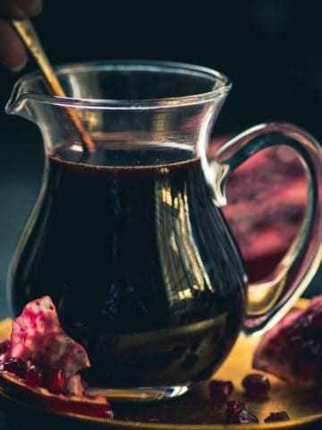 Pomegranate molasses is an essential ingredient in traditional Middle Eastern cooking and it is made by reducing pomegranate juice and sugar. Make it at home using my simple recipe (vegan, gluten-free)