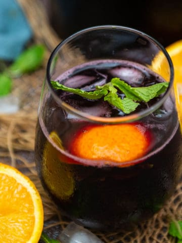 Make this fizzy fruity red wine spritzer using just 2 ingredients in 2 minutes. This easy summer cocktail is super refreshing and great to serve for parties or get-togethers.